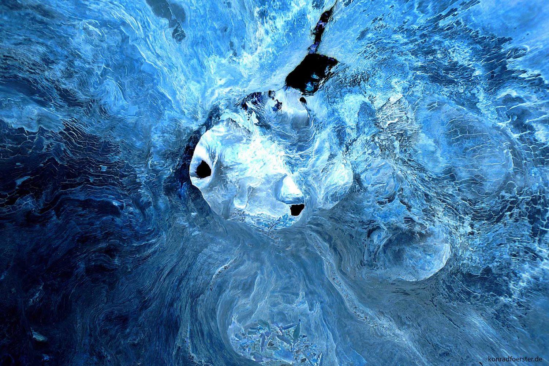 It looks like a pufferfish for me in a frosty blue ocean or sea.